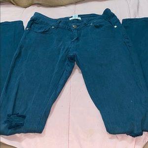 Dark turquoise distressed jeans